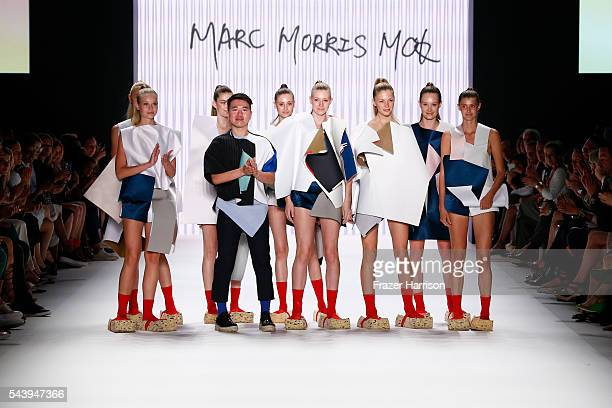 Marc Morris Mok and models acknowledge the applause of the audience after the fashion talent award 'Designer for Tomorrow' by Peek Cloppenburg and...