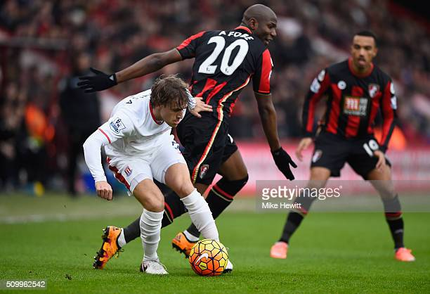 Marc Muniesa of Stoke City and Benik Afobe of Bournemouth compete for the ball during the Barclays Premier League match between AFC Bournemouth and...