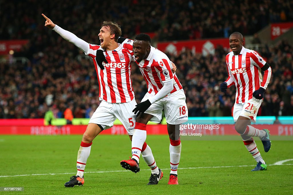 Marc Muniesa (L) of Stoke City celebrates scoring his team's second goal with his team mate Mame Biram Diouf (C) during the Premier League match between Stoke City and Burnley at Bet365 Stadium on December 3, 2016 in Stoke on Trent, England.