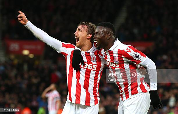 Marc Muniesa of Stoke City celebrates scoring his team's second goal with his team mate Mame Biram Diouf during the Premier League match between...