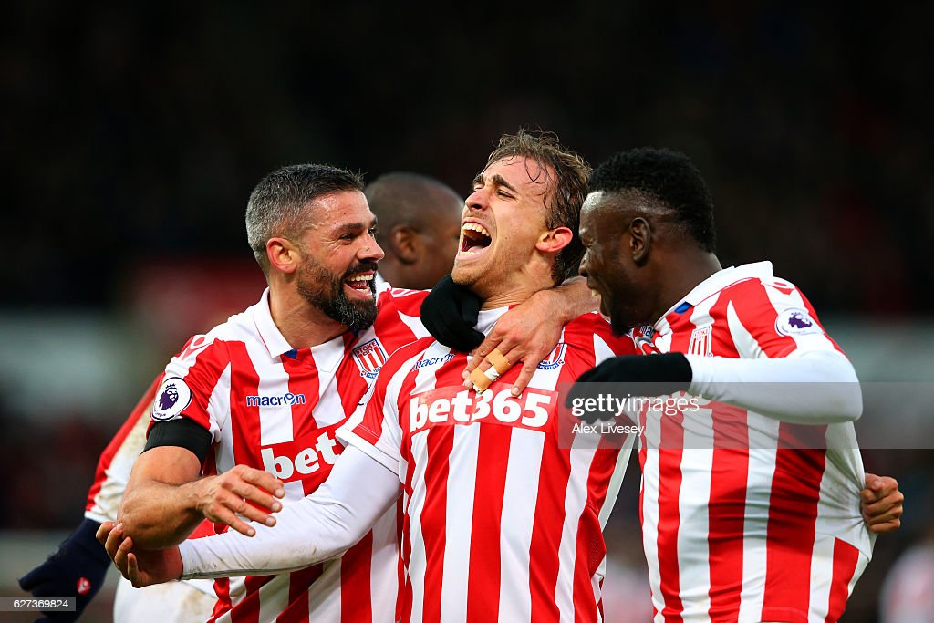 Marc Muniesa (C) of Stoke City celebrates scoring his team's second goal with his team mates during the Premier League match between Stoke City and Burnley at Bet365 Stadium on December 3, 2016 in Stoke on Trent, England.