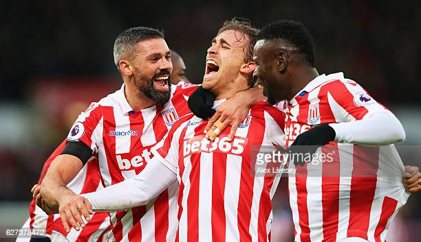 Marc Muniesa of Stoke City celebrates scoring his team's second goal with his team mates during the Premier League match between Stoke City and...