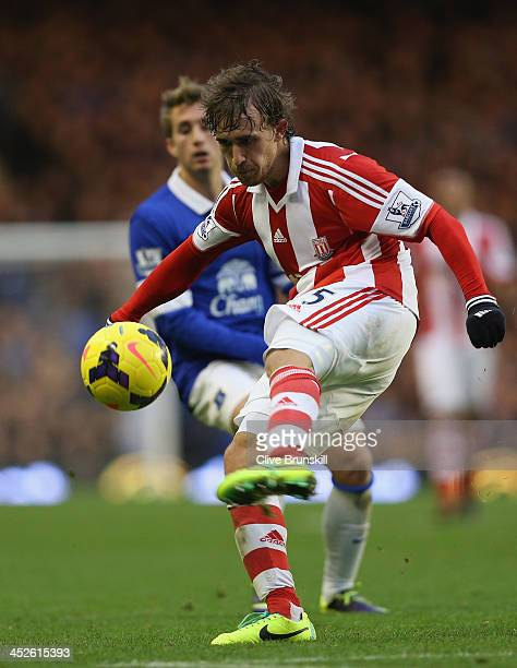 Marc Muniesa of Stoke City clears the ball away from Gerard Deulofeu of Everton during the Barclays Premier League match between Everton and Stoke...