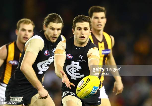 Marc Murphy of the Blues and Bryce Gibbs of the Blues compete for the ball during the round 22 AFL match between the Carlton Blues and the Hawthorn...