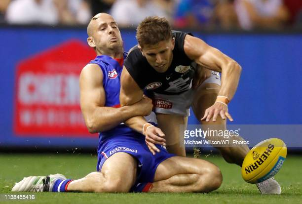 Marc Murphy of the Blues and Tory Dickson of the Bulldogs compete for the ball during the 2019 AFL round 05 match between the Western Bulldogs and...