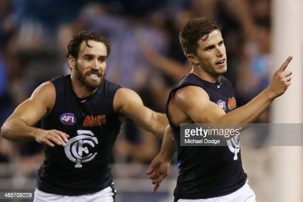 Marc Murphy of the Blues celebrates a goal with Andrew Walker during the round five AFL match between the Western Bulldogs and the Carlton Blues at...