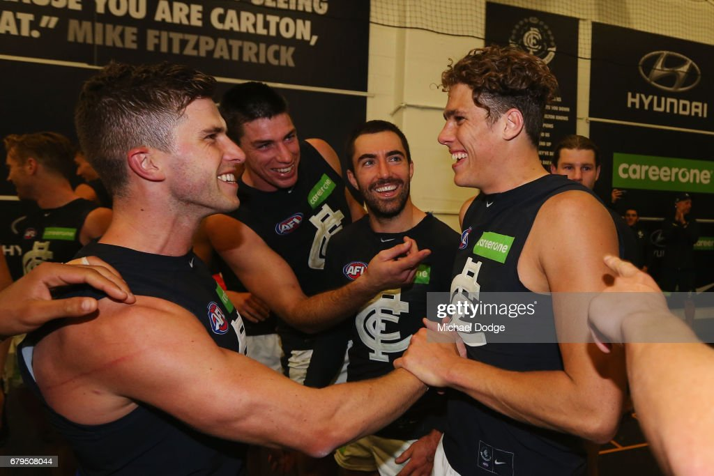 Marc Murphy of the Blues celebrates the win Charlie Curnow (R) during the round seven AFL match between the Collingwood Magpies and the Carlton Blues at Melbourne Cricket Ground on May 6, 2017 in Melbourne, Australia.