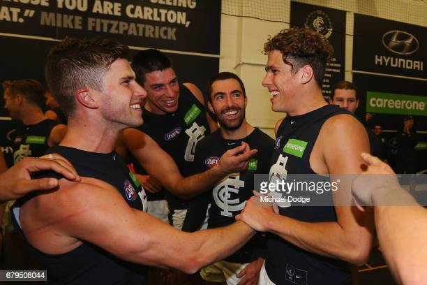 Marc Murphy of the Blues celebrates the win Charlie Curnow during the round seven AFL match between the Collingwood Magpies and the Carlton Blues at...