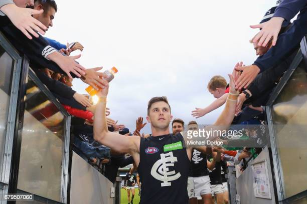 Marc Murphy of the Blues celebrates the win with fans during the round seven AFL match between the Collingwood Magpies and the Carlton Blues at...