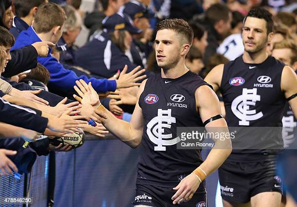 Marc Murphy of the Blues high fives fans after winning the round 13 AFL match between the Carlton Blues and the Gold Coast Titans at Etihad Stadium...