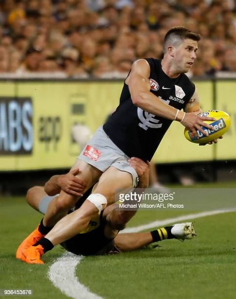 Marc Murphy of the Blues is tackled by Alex Rance of the Tigers during the 2018 AFL round 01 match between the Richmond Tigers and the Carlton Blues...