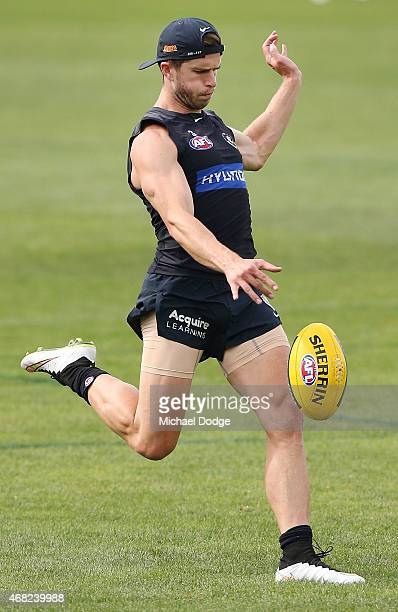 Marc Murphy of the Blues kicks the ball during a Carlton Blues AFL training session at Ikon Park on April 1 2015 in Melbourne Australia