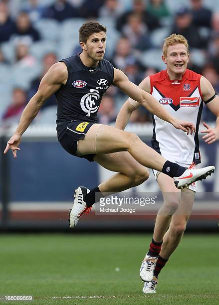 Marc Murphy of the Blues kicks the ball during the round six AFL match between the Carlton Blues and the Melbourne Demons at Melbourne Cricket Ground...