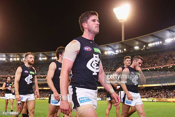 Marc Murphy of the Blues leads the team off after defeat during the round one AFL match between the Richmond Tigers and the Carlton Blues at...