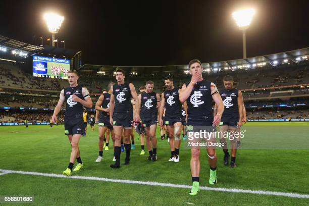Marc Murphy of the Blues leads the team off after defeat during the round one AFL match between the Carlton Blues and the Richmond Tigers at...