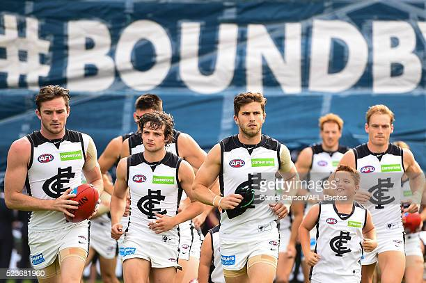 Marc Murphy of the Blues leads the team though the banner during the 2016 AFL Round 05 match between the Fremantle Dockers and the Carlton Blues at...