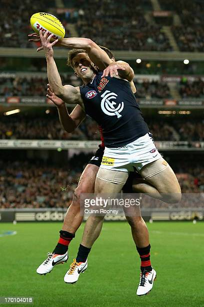 Marc Murphy of the Blues marks during the round 11 AFL match between the Essendon Bombers and the Carlton Blues at Melbourne Cricket Ground on June 7...