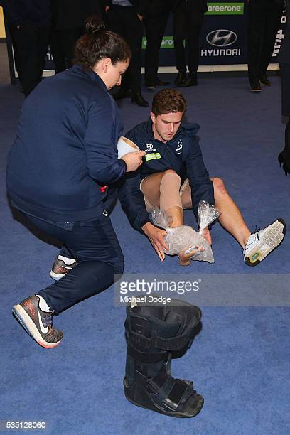 Marc Murphy of the Blues takes off his moonboot and ices his foot after their win in the round 10 AFL match between the Carlton Blues and the Geelong...