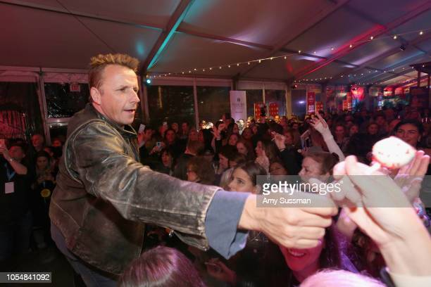 Marc Murphy passes out desserts to guests during Food Network's 25th Birthday Party Celebration at the 11th annual New York City Wine Food Festival...