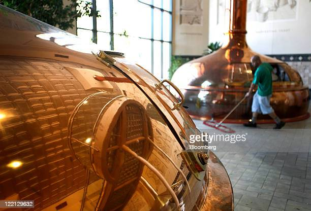 Marc Nobriga a brewer for Sierra Nevada Brewing Co sweeps the floor at the company's facility in Chico California US on Wednesday Aug 24 2011 The...