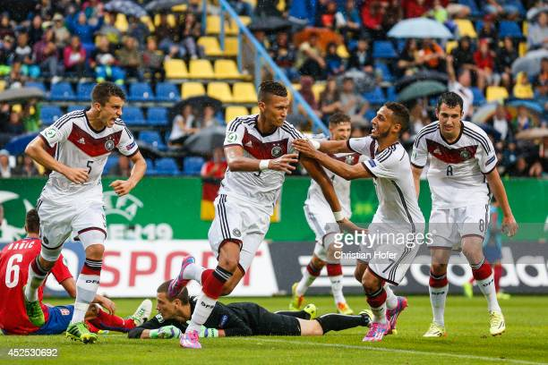Marc Oliver Kempf Davie Selke Hany Mukhtar and Levin Mete Oeztunali of Germany celebrate after scoring during the UEFA Under19 European Championship...