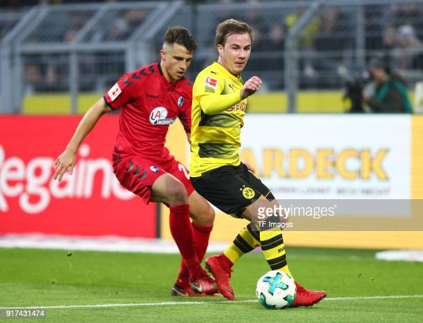 Marc Oliver Kempf of Freiburg and Mario Goetze of Dortmund battle for the ball during the Bundesliga match between Borussia Dortmund and SportClub...