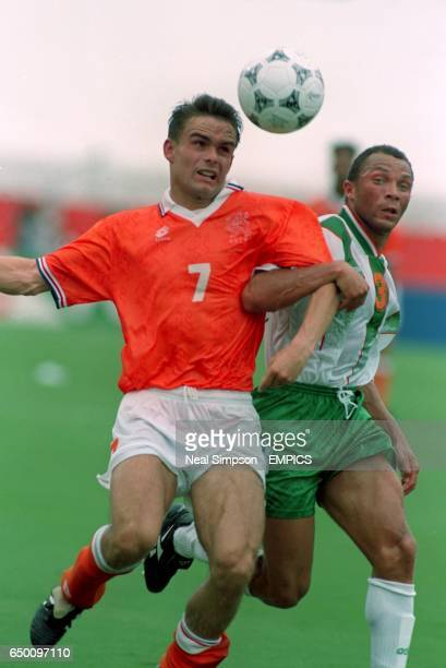 Marc Overmars Netherlands battles with Teri Phelan Ireland