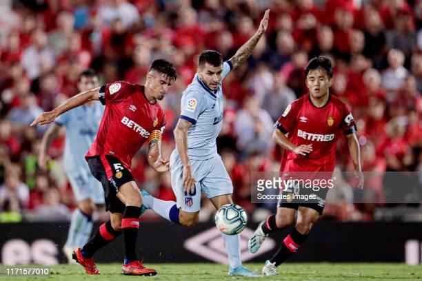 Marc Pedraza of Real Mallorca, Angel Correa of Atletico Madrid, Takefusa Kubo of Real Mallorca during the La Liga Santander match between Real...