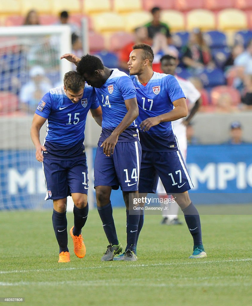 Marc Pelosi #15 of the United States is congratulated by teammates Fatai Alashe #14 and Jerome Kiesewetter #17 after he scored the winning goal against Canada during the third place CONCACAF Olympic Qualifying match at Rio Tinto Stadium on October 13, 2015 in Sandy, Utah. The United States beat Canada 2-0.