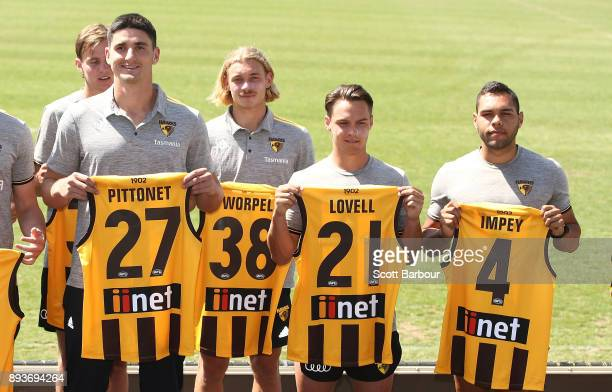 Marc Pittonet James Worpel Kieran Lovell and Jarman Impey of the Hawks hold their new guernsey numbers at the jumper number reveal during a Hawthorn...