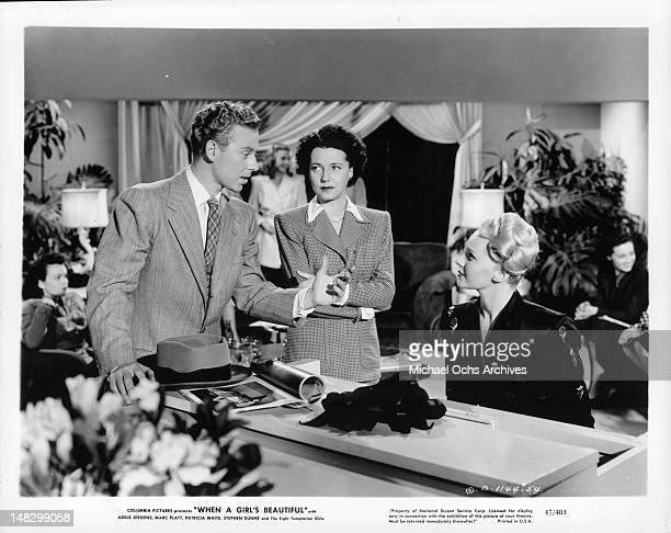Marc Platt gesturing at Adele Jergens while Mona Barrie watches in a scene from the film 'When A Girl's Beautiful' 1947