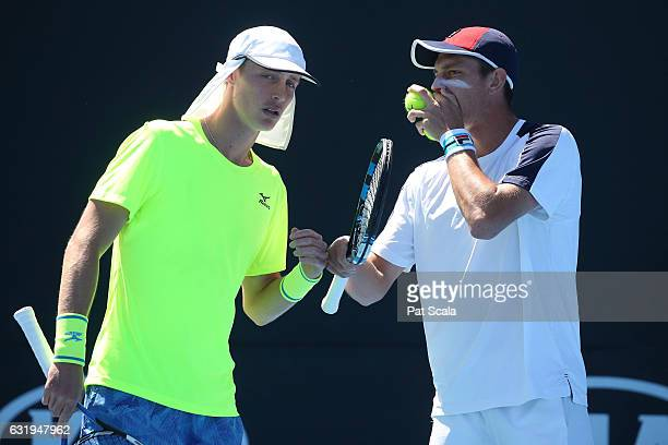 Marc Polmans and Andrew Whittington of Australia talk tactics in their first round doubles match against Yen-Hsun Lu and Jiri Vesely on day three of...