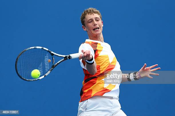 Marc Polmans of Australia plays a forehand in his first round junior boys' match against Pedro Martinez Portero of Spain during the 2014 Australian...