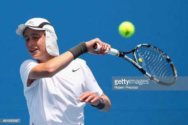 Marc Polmans of Australia plays a forehand in his first round match against JohnPatrick Smith of Australia in the Australian Open 2014 Qualifying at...