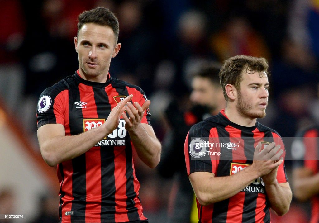 Marc Pugh and Ryan Fraser of AFC Bournemouth show appreciation to the fans following the Premier League match between AFC Bournemouth and Stoke City at Vitality Stadium on February 3, 2018 in Bournemouth, England.