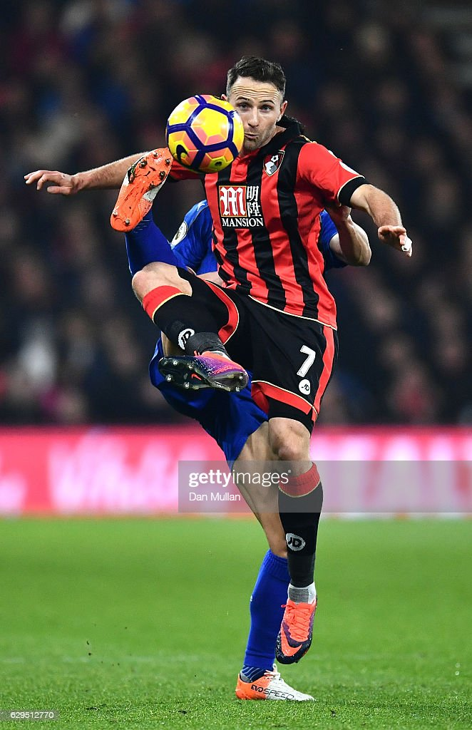 Marc Pugh of AFC Bournemouth controls the ball under pressure from Luis Hernandez of Leicester City during the Premier League match between AFC Bournemouth and Leicester City at the Vitality Stadium on December 13, 2016 in Bournemouth, England.
