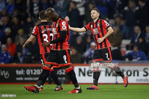 Marc Pugh of AFC Bournemouth is congratulated by teammates after scoring the opening goal during the Premier League match between AFC Bournemouth and...