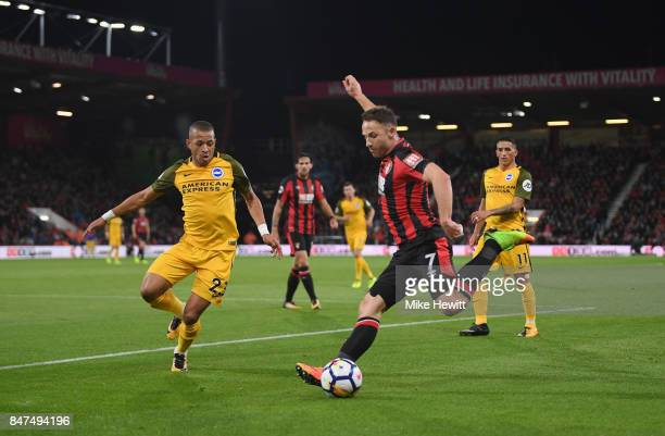 Marc Pugh of AFC Bournemouth is faced by Liam Rosenior of Brighton and Hove Albion during the Premier League match between AFC Bournemouth and...