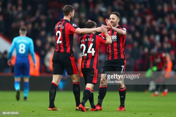 Marc Pugh of AFC Bournemouth Ryan Fraser of AFC Bournemouth and Simon Francis of AFC Bournemouth celebrates the victory after the Premier League...