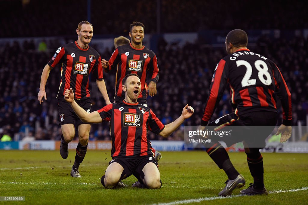 Marc Pugh (C) of Bournemouth celebrates scoring his team's second goal with his team mates during the Emirates FA Cup Fourth Round match between Portsmouth and AFC Bournemouth at Fratton Park on January 30, 2016 in Portsmouth, England.