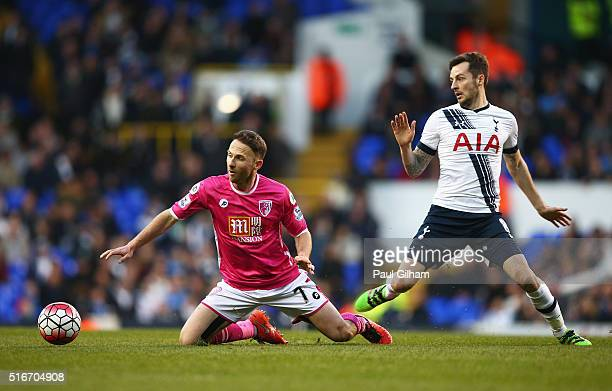 Marc Pugh of Bournemouth is challenged by Ryan Mason of Tottenham Hotspur during the Barclays Premier League match between Tottenham Hotspur and AFC...