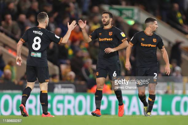 Marc Pugh of Hull celebrates with team mate Kevin Stewart after scoring to make it 2-1 during the Sky Bet Championship match between Norwich City and...