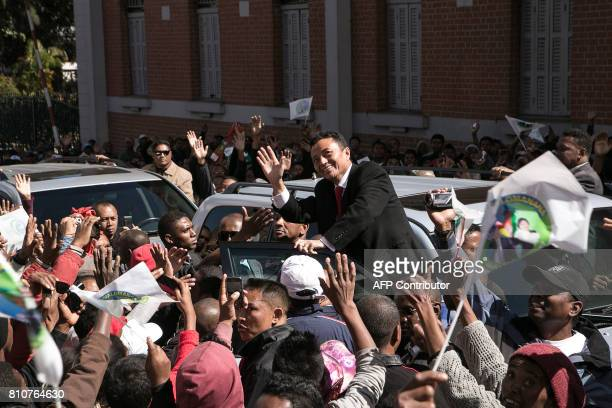 Marc Ravalomanana, former President of Madagascar, waves as he celebrates the 15th anniversary of his party Tiako i Madagasikara with supporters,...