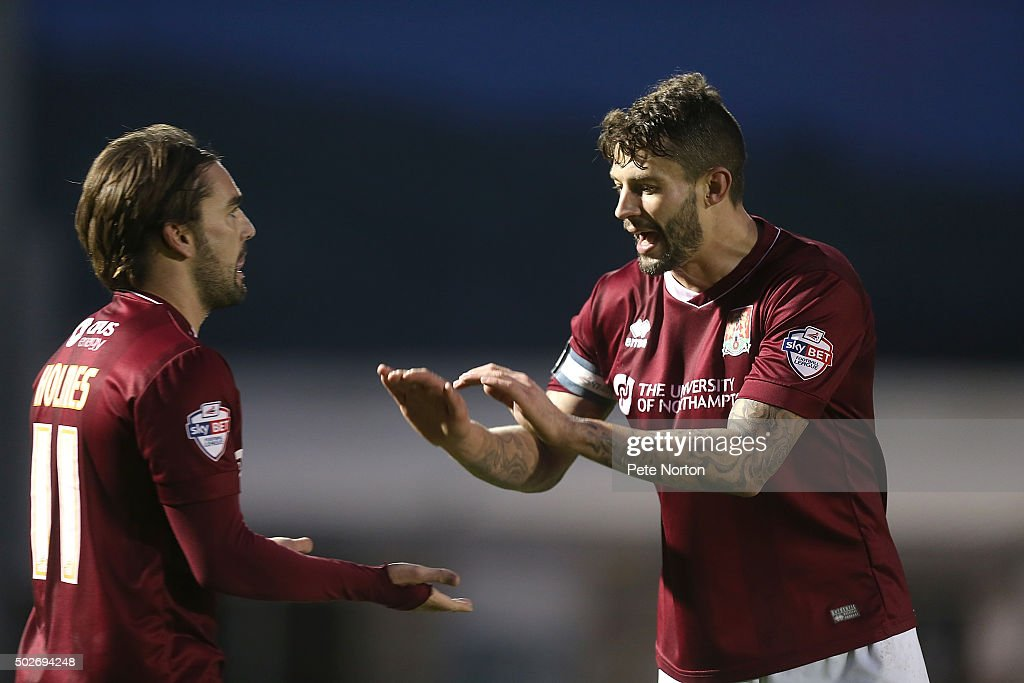 Marc Richards of Northampton Town celebrates with team mate Ricky Holmes after scoring his sides goal during the Sky Bet League Two match between Northampton Town and Accrington Stanley at Sixfields Stadium on December 28, 2015 in Northampton, England.