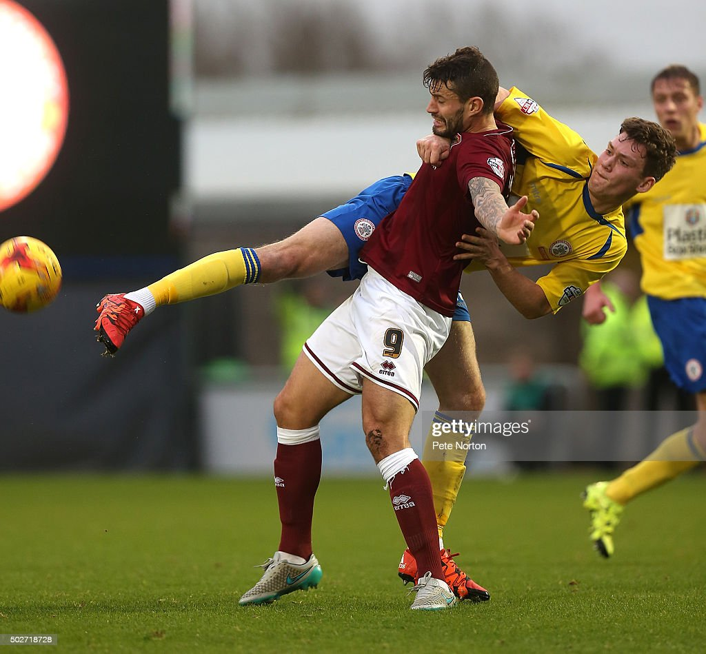 Marc Richards of Northampton Town contests the ball with Joe Wright of Accrington Stanley during the Sky Bet League Two match between Northampton Town and Accrington Stanley at Sixfields Stadium on December 28, 2015 in Northampton, England.