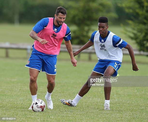 Marc Richards of Northampton Town controls the ball watched by Ivan Toney during a training session at Moulton College on July 8 2014 in Northampton...