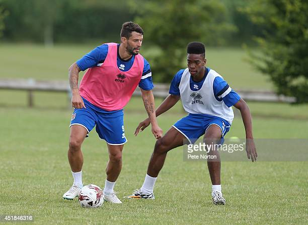 Marc Richards of Northampton Town looks to play the ball watched by Ivan Toney during a training session at Moulton College on July 8 2014 in...