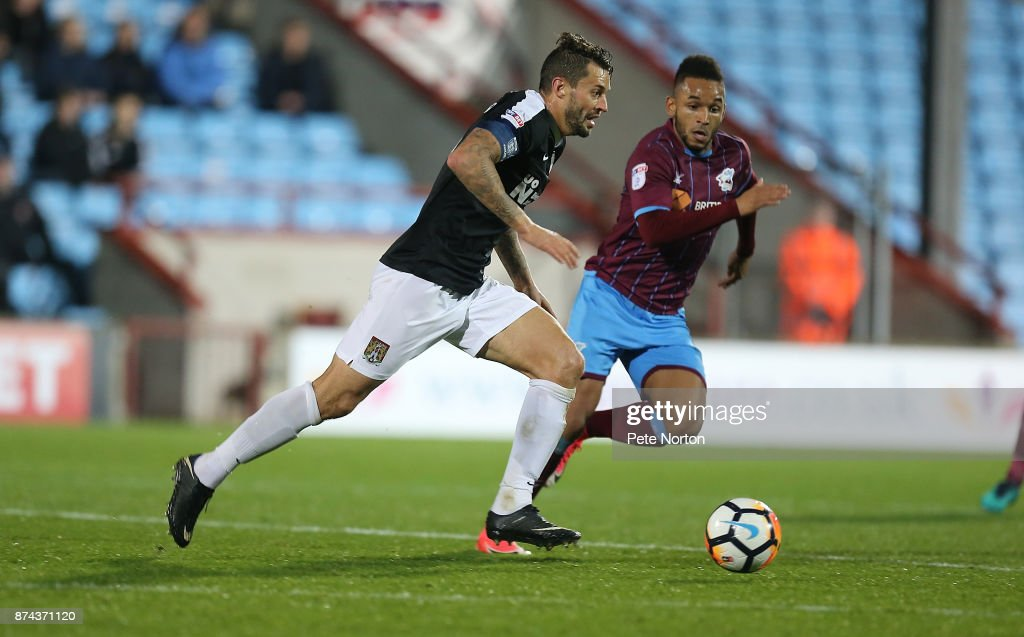 Marc Richards of Northampton Town moves forward with the ball during the Emirates FA Cup First Round Replay match between Scunthorpe United and Northampton Town at Glanford Park on November 14, 2017 in Scunthorpe, England.