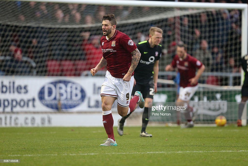 Marc Richards of Northampton Town turns to celebrate after scoring his sides second goal during the Sky Bet League Two match between Northampton Town and York City at Sixfields Stadium on February 6, 2016 in Northampton, England.