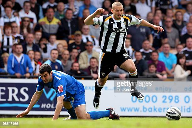 Marc Richards of Port Vale battles for the ball with Mike Edwards of Notts County during the Coca Cola League Two match between Port Vale and Notts...